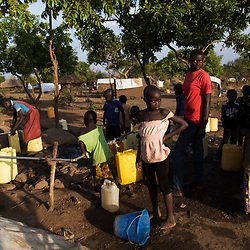 Refugee children from South Sudan collect water at a distribution point at the Bidi Bidi refugee settlement in north Uganda. <br />