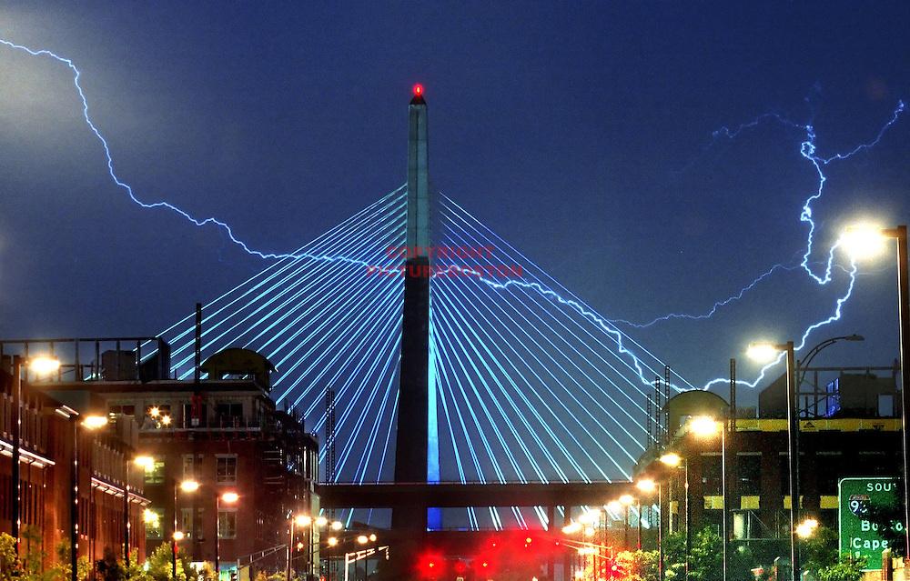 Lightning strikes over and behind Boston's Zakim Bridge