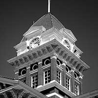 Lake County Courthouse clock in Crown Point Indiana black and white photo. The Lake County Courthouse was built in 1878 and is nicknamed The Grand Old Lady. The courthouse architecture is Romanesque and Georgian. Today it's used for events and has a ballroom and restaurants.