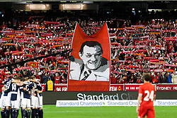 © Licensed to London News Pictures. 24/7/2013. Liverpool supporters   holding up a large banner of Bob Paisley  during the Melbourne Victory Vs Liverpool F.C at the Melbourne Cricket Ground, Melbourne, Australia. Photo credit : Asanka Brendon Ratnayake/LNP