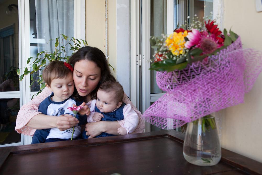 Federica and Giulio - Naples, April 2016. Federica, 30 years old, with her two kids Eugenio, one year old, and Eleonora, born on December 2015.<br />Federica has been aware to be affected by multiple sclerosis from 2012. Despite the difficulties, she did not allow the disease to compromise her happiness and the desire to be a mother.<br /><br />Federica e Giulio - Napoli, Aprile  2016.&nbsp;Federica, 30 anni, con i suoi due figli Eugenio, un anno, ed Eleonora, nata nel Dicembre 2015.<br />Federica ha saputo di essere affetta da sclerosi multipla nel 2012. Nonostante le difficolt&agrave; non ha permesso che la patologia compromettesse la sua felicit&agrave; e desiderio di essere madre.