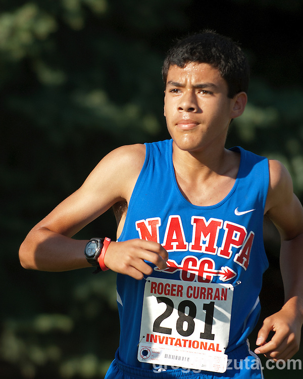 Nampa freshman Pablo Lopez during the first loop of the Roger Curran Invitational 5k varsity race at West Park in Nampa, Idaho on September 14, 2013. Lopez finished with at time of 18:40.10.
