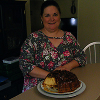 ALICE ORTIZ/BUY AT PHOTOS.MONROECOUNTYJOURNAL.COM<br /> Roxanne Oakes stands with her famous pecan pie pound cake.