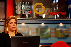 Macky Arenas works as a anchor woman at Globovision.  Globovision reporters began to cover themselves as officials from CONATEL, a government telecommunication organization, siezed equipment from Globovision, one of the country's main news station.  The channel is often alligned with the opposition to Chavez and claims this was an attempt to from the government to quiet the station.  The government claimed the station was not authorized to use certain frequencies that they were using.