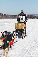 Musher Anna Berington competing in the 45rd Iditarod Trail Sled Dog Race on the Chena River after leaving the restart in Fairbanks in Interior Alaska.  Afternoon. Winter.
