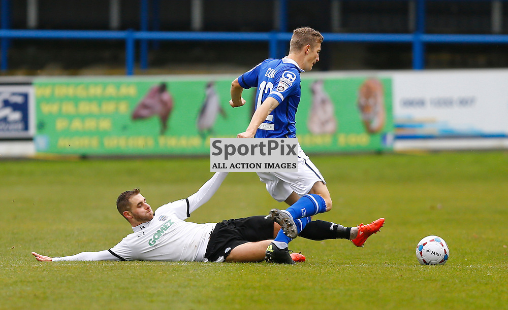 Dover's midfielder Nick Deverdics (17) slides in on Macclesfield Defender Dan Cowan (12). Dover Athletic against Macclesfield Town in the Vanorama Conference Premier. At Crabble Stadium, Dover, Kent. (c) Matt Bristow | SportPix.org.uk
