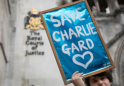 © Licensed to London News Pictures. 13/07/2017. London, UK. Supporters of Charlie Gard protest outside The High Court in London. The parents of terminally ill Charlie Gard have returned to the High Court in light of new evidence relating to potential treatment for their son's condition. An earlier lengthy legal battle ruled that Charlie could not be taken to the US for experimental treatment. London, UK. Photo credit: Peter Macdiarmid/LNP
