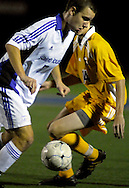 9 NOV. 2010 -- ST. LOUIS -- St. Louis University High School soccer player Sam Steuer (7) pushes the ball past Christian Brothers College High School's Tim Michel (14) during the MSHSAA Class 3 Sectional game at SLUH Tuesday, Nov. 9, 2010. The Jr. Bills won, 2-1, on a pair of first half goals by Ryan Merrifield. SLUH will take on Jackson High School Saturday, Nov. 13 at Jackson. Image © copyright 2010 Sid Hastings.