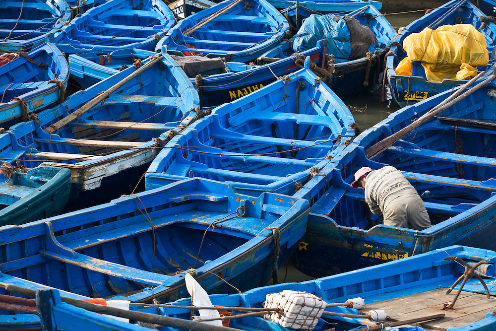 Fishing boats packed tight in the Moroccan fishing town of Essaouira. The blue fishing boats of Essaouira are famous