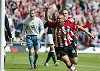 Photo. Chris Ratcliffe, Digitalsport<br /> Southampton v Manchester United. Barclays Premiership. 15/05/2005<br /> Nigel Quashie and Brett Ormerod celebrate the own goal of John O'Shea, as Roy Carroll shows his displeasure