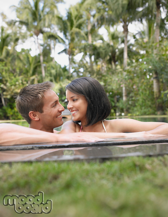 Happy Young Couple in Swimming Pool