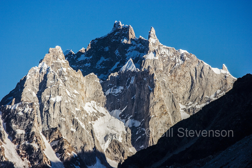 Alpenglow on mountains at sunrise on the Biafo glacier in the Karakoram Himalaya of Pakistan
