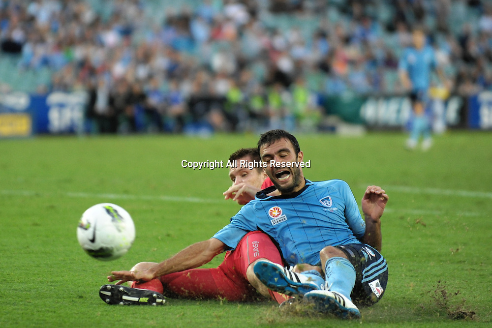 22.12.2011 Sydney, Australia.Adelaide defender Nigel Boogaard brings down Sydney forward  Bruno Cazarine to give away a penalty during the A-League game between Sydney FC and Adelaide United played at the Sydney Football Stadium.