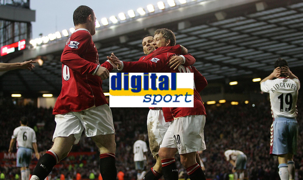 Photo: Paul Thomas.<br /> Manchester United v Aston Villa. The FA Cup. 07/01/2007.<br /> <br /> Ole Gunnar Solskjaer of Man Utd (20) celebrates his goal with team-mates Wayne Rooney (L) and Ryan Giggs after winning the game also.