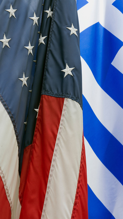 Flags of U.S.A. and Greece.