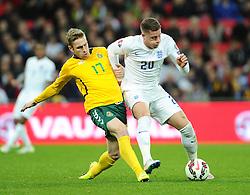 Ross Barkley of England (Everton) battles for the ball with Vaidas Slavickas of Lithuania  - Photo mandatory by-line: Joe Meredith/JMP - Mobile: 07966 386802 - 27/03/2015 - SPORT - Football - London - Wembley Stadium - England v Lithuania - UEFA EURO 2016 Qualifier