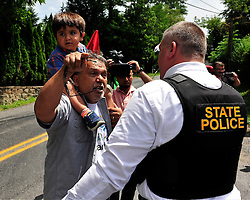Protestors clash with local security and police outside of where exiled Turkish cleric and muslim imam Fethullah Gulen answers questions from members of the media during a rare interview at his Pocono Mountain compound July 16, 2016 in Saylorsburg, Pennsylvania.