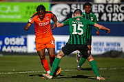 Luton Town midfielder Pelly-Ruddock Mpanzu tackled by Coventry City defender Dominic Hyam (15) during the EFL Sky Bet League 1 match between Luton Town and Coventry City at Kenilworth Road, Luton, England on 24 February 2019.