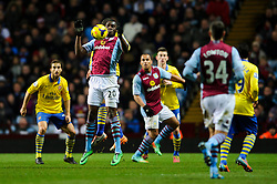 Aston Villa Forward Christian Benteke (BEL) compete in the air during the second half of the match - Photo mandatory by-line: Rogan Thomson/JMP - Tel: Mobile: 07966 386802 - 13/01/2014 - SPORT - FOOTBALL - Villa Park, Birmingham - Aston Villa v Arsenal  - Barclays Premier League.
