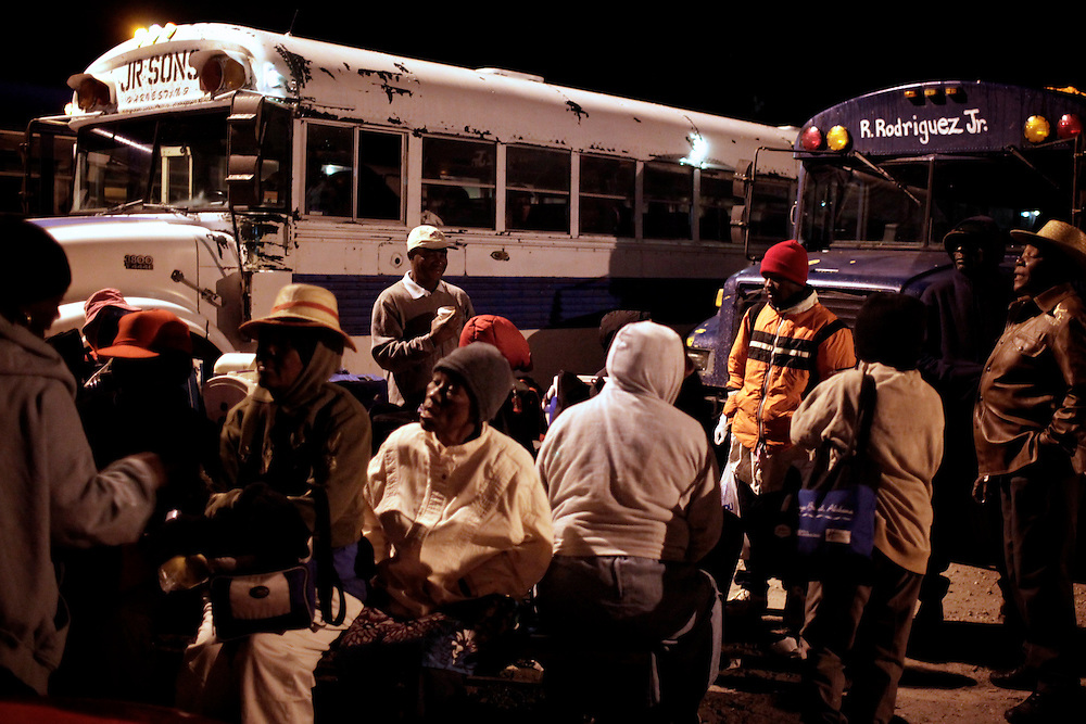 Farmworkers board buses in Immokalee to take them to the tomato fields. photo by Greg Kahn