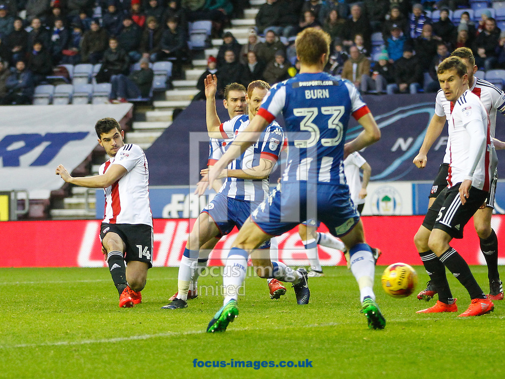 John Egan of Brentford attempts a shot during the Sky Bet Championship match between Wigan Athletic and Brentford at the DW Stadium, Wigan<br /> Picture by Mark D Fuller/Focus Images Ltd +44 7774 216216<br /> 21/01/2017