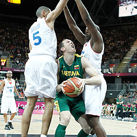 02 August 2012: Nicolas Batum and Ali Traore defend on Lithuania Darius Songaila during 82-74 Team France victory over Team Lithuania, during the men's basketball preliminary, at the Basketball Arena, in London, Great Britain.