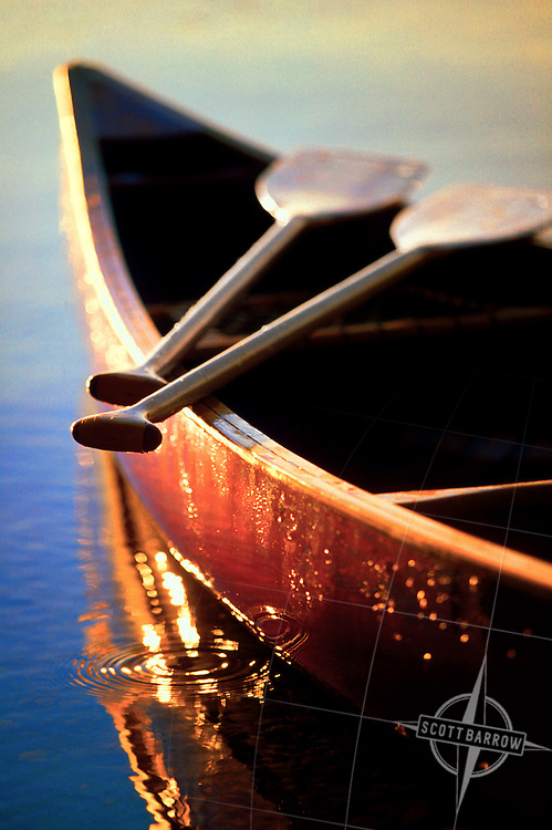 wooden canoe on calm water.