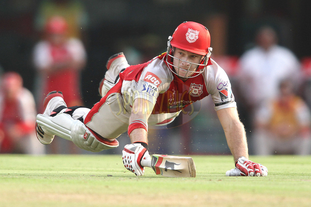 David Miller of the Kings XI Punjab dives to make is ground during match 33 of the the Indian Premier League (IPL) 2012  between The Kings X1 Punjab and The Mumbai Indians held at the Punjab Cricket Association Stadium, Mohali on the 25th April 2012..Photo by Shaun Roy/IPL/SPORTZPICS