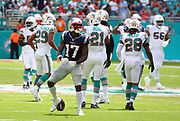 Sep 15, 2019; Miami Gardens, FL, USA;  New England Patriots wide receiver Antonio Brown (17) celebrates after officially making his first catch as a Patriot against the Miami Dolphins during an NFL game at Hard Rock Stadium in Miami Gardens, FL. The Patriots beat the Dolphins 43-0. (Steve Jacobson/Image of Sport)