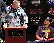 LAS VEGAS, NEVADA, JULY 9, 2009: Brock Lesnar (left) addresses a comment to Frank Mir (seated) during the pre-fight press conference for UFC 100 inside the House of Blues in Las Vegas, Nevada