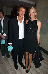 The HON.SOPHIA HESKETH and ROBIE UNIACKE at a private screening of 'Sketches of Frank Gehry in association with jewellers Tiffany held at the Curzon Cinema, Mayfair on 10th May 2006 followed by a party at Nobu Mayfair, Berkeley Street.<br />