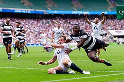 Josh Bassett of the England XV scores a try in the first half despite the challenge of Niyi Adeolokun of the Barbarians - Mandatory byline: Patrick Khachfe/JMP - 07966 386802 - 02/06/2019 - RUGBY UNION - Twickenham Stadium - London, England - England XV v Barbarians - Quilter Cup International