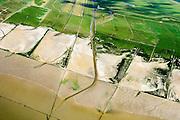 Nederland, Friesland, Gemeente Ferweradeel, 05-08-2014; <br /> Noorderleeg (Noarderleech) ook Noard-Fryslan Butendyks , buitendijkse polder en kweldergebied grenzend aan het Friesche Wad. Landaanwinning door middel van zogenaamde  kwelderwerken: vakken begrenst door rijshouten golfbrekers die als gevolg hebben dat het slib kan bezinken. Als de kwelders hoog genoeg groeien er er kwelderplanten.<br /> Land reclamation, Noorderleeg (Northern Void), polder and salt marsh area outside the dikes. The so-called salt marsh works consist of square sections, bordered by brushwood breakwaters causing the sludge to settle.<br /> luchtfoto (toeslag); aerial photo (additional fee required); foto Siebe Swart / photo Siebe Swart