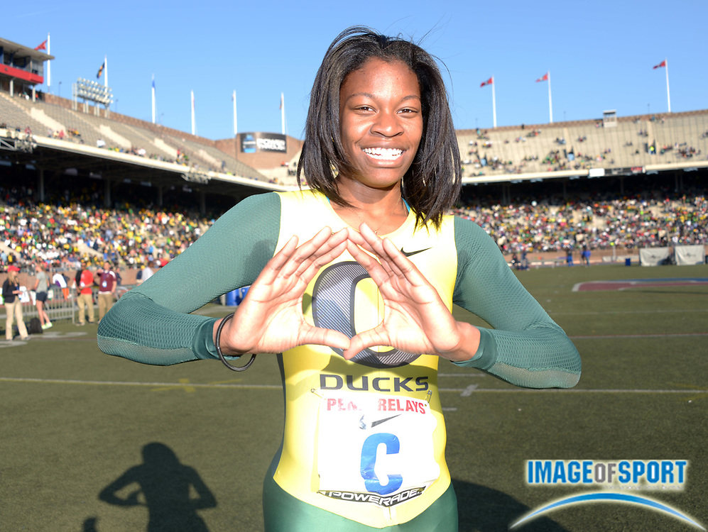 Apr 27, 2013; Philadelphia, PA, USA; Phyllis Francis of Oregon poses after running the anchor leg on the Ducks womens 4 x 400m relay that set a Championship of America meet record of 3:26.73 in the 119th Penn Relays at Franklin Field.