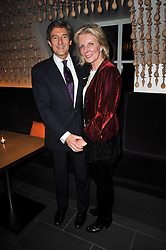 NIGEL HAVERS and his wife Georgiana Bronfman at the launch of Nicky Haslam's autobiography Redeeming Features held at Aqua Nueva, 240 regent Street, London on 5th November 2009.