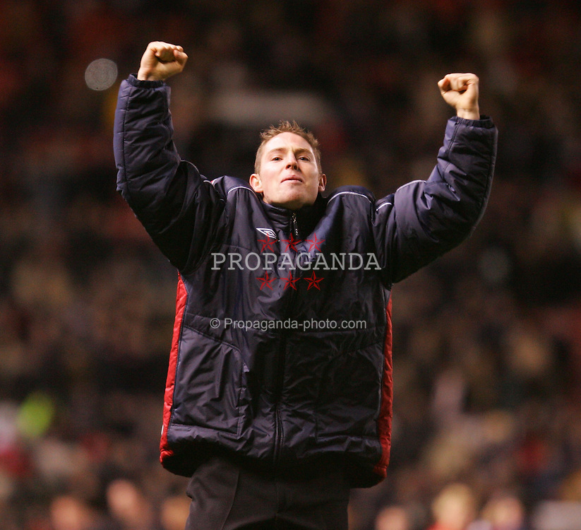 MANCHESTER, ENGLAND - SATURDAY JANUARY 8th 2005: Exeter City's injured captain Glenn Cronin celebrates his side's 0-0 draw with Manchester United in the FA Cup 3rd Round match at Old Trafford. (Pic by David Rawcliffe/Propaganda)