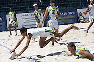 Camps Bay, A player dives over for a try during the Oasis SKW Camps Bay Beach Touch Rugby Tournament held on the 2 February 2008, Cape Town, South Africa...Image © Sportzpics