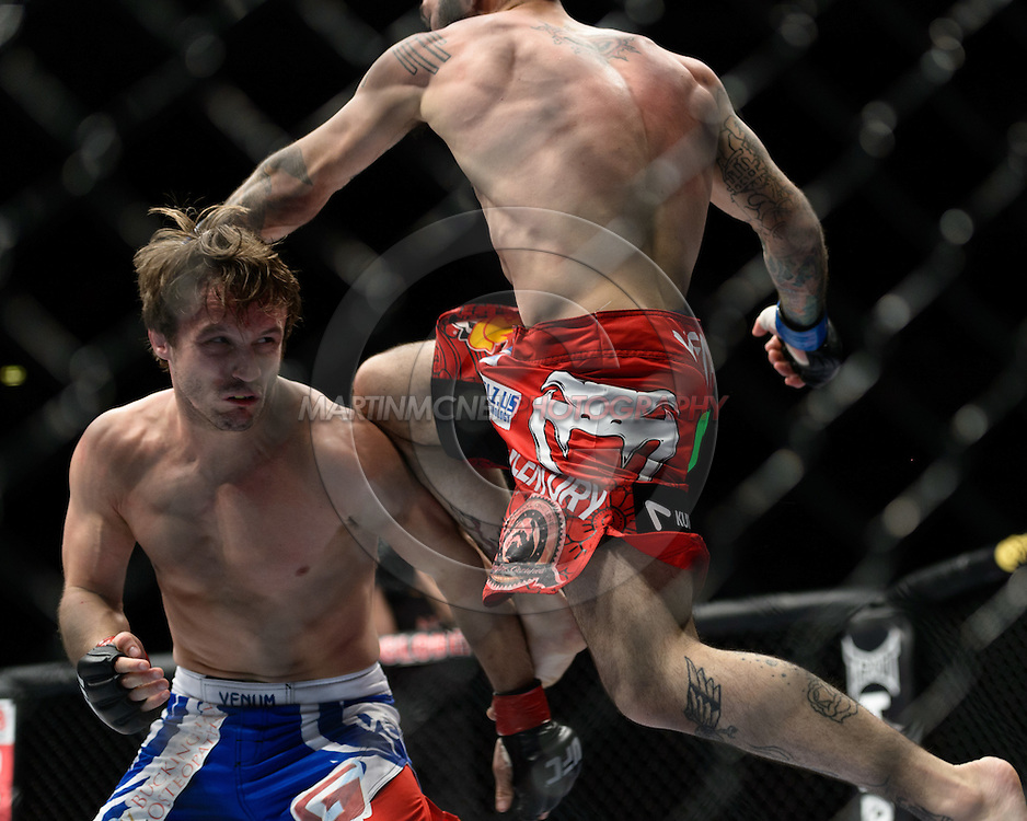 """STOCKHOLM, SWEDEN, APRIL 14:  Brad Pickett (blue/red shorts) and Damacio Page (red shorts) during """"UFC on Fuel TV: Gustafsson vs. Silva"""" inside the Ericsson Globe Arena in Stockholm, Sweden"""