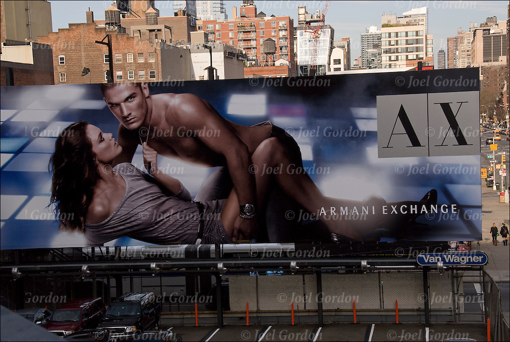 "Sex is everywhere in the American Culture today. advertising billboard in which sex is used to sell a product  Armaini Exchange uses semi nude couple in their ""Sex Sells"" billboard"