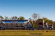 Typical shiny American liquid tanker truck on trucking route Interstate 10 in Louisiana, USA