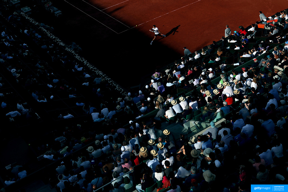 2017 French Open Tennis Tournament - Day Eight.  Novak Djokovic of Serbia in action against Albert Ramos-Vinolas of Spain as the light fades on Philippe-Chatrier Court during the Men's Singles round four match at the 2017 French Open Tennis Tournament at Roland Garros on June 4th, 2017 in Paris, France.  (Photo by Tim Clayton/Corbis via Getty Images)