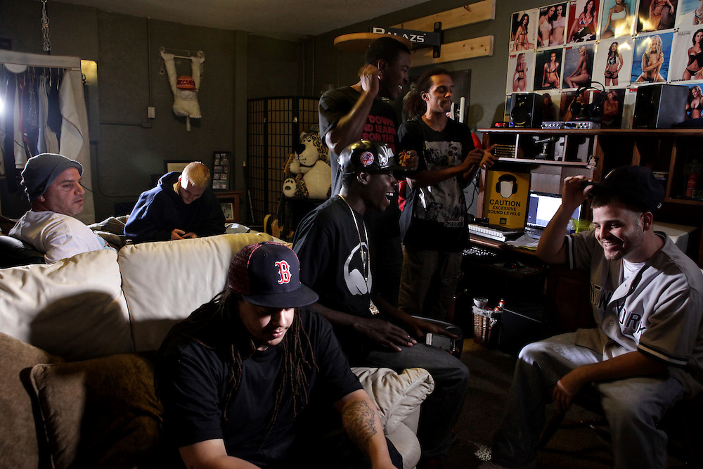 "Squeezing between a bed, a computer desk and a couch are seven members of the hip hop group, Hygher Level - a group of 10 emcees who have banded together for a ""strength in numbers"" approach breaking in to the hip hop scene. Here they gather at the home of Colby Roderick, a.k.a Steady, in Cape Coral, Fla."
