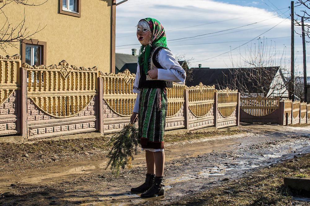 KRASNOILSK, UKRAINE - JANUARY 14: A villager in costume celebrates the winter festival of Malanka on January 14, 2015 in Krasnoilsk, Ukraine. The holiday, which involves dressing in elaborate costumes and going from house to house as a group singing traditional songs, is celebrated on New Year's Day of the Orthodox calendar, a week after Orthodox Christmas. (Photo by Brendan Hoffman/Getty Images) *** Local Caption ***