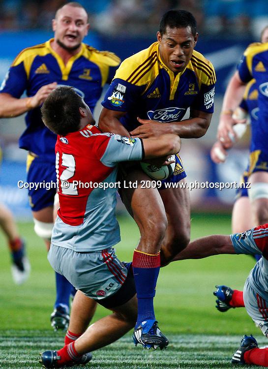 Highlanders Alando Soakai is tackled by Crusader Tim Bateman during a Super 14 rugby match, Otago Highlanders versus Canterbury Crusaders. Carisbrook, Dunedin, New Zealand. Saturday 7 March 2009. Photo: Simon Watts/PHOTOSPORT