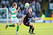 Yeovil Town's Ryan Bird and Carlisle Utd's Michael Raynes during the Sky Bet League 2 match between Yeovil Town and Carlisle United at Huish Park, Yeovil, England on 25 March 2016. Photo by Graham Hunt.
