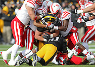 November 23 2012: Iowa Hawkeyes running back Mark Weisman (45) is brought down by Nebraska Cornhuskers safety P.J. Smith (13) during the first half of the NCAA football game between the Nebraska Cornhuskers and the Iowa Hawkeyes at Kinnick Stadium in Iowa City, Iowa on Friday November 23, 2012. Nebraska defeated Iowa 13-7 in the Heroes Game on Black Friday.