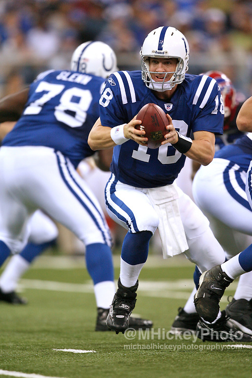 WireImage #--Indianapolis quarterback Peyton Manning looks to hand off during action against Buffalo at the RCA Dome in Indianapolis, Indiana on November 12, 2006.