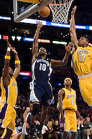 27 March 2007: Guard Junior Harrington of the Memphis Grizzlies shoots the ball as Andrew Bynum of the Los Angeles Lakers blocks his shot during the first half of the Grizzlies 88-86 victory over the Lakers at the STAPLES Center in Los Angeles, CA.