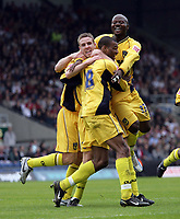 Photo: Rich Eaton.<br /> <br /> Oxford United v Leyton Orient. Coca Cola League 2. 06/05/2006.<br /> <br /> Oxford Uniteds Eric Sabin (18) celebrates scoring Oxfords first goal with Barry Quin (L) and Tchamp N'Toya (R)