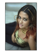 Actress and model Riya Sen photographed for a PR campaign by the World Gold Council for the Times of India's Westside Plus. Scan from 35mm transparency. By Siddharth Siva Model and Indian actress Riya Sen poses for a portrait in Mumbai, India